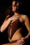 Brunette in lingerie feeling good poster