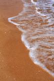sea waves foam on the beach poster