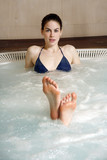 Young woman in jacuzzi at a spa