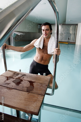 Young man in a swimming pool at a spa