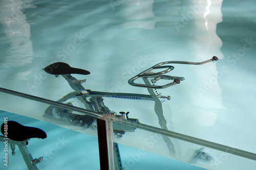 An exercise bicycle in a swimming pool