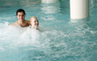 Young couple swimming in spa pool