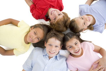 Circle of five young friends smiling
