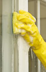 woman cleaning glass