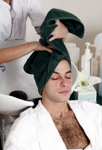 Young man having his hair  washed at a salon