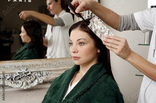 Young woman  having her hair  colored