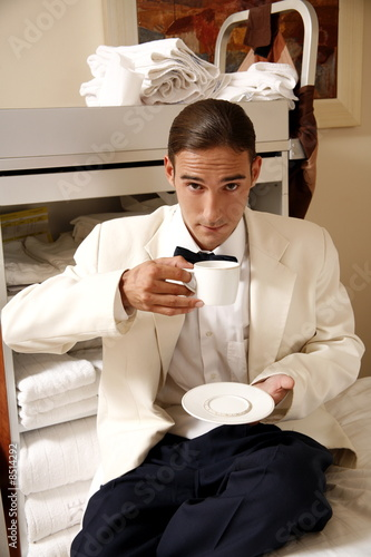 Hotel waiter taking a break