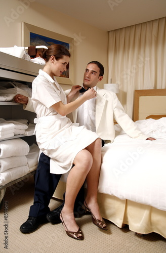 Hotel maid and waiter taking a break