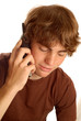 attractive teen boy talking on cordless telephone