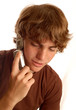 attractive teen boy talking on cell phone