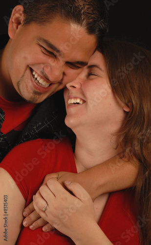 laughing attractive spanish and caucasian ethnic mix couple