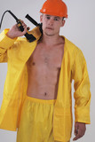 worker in yellow workwear poster