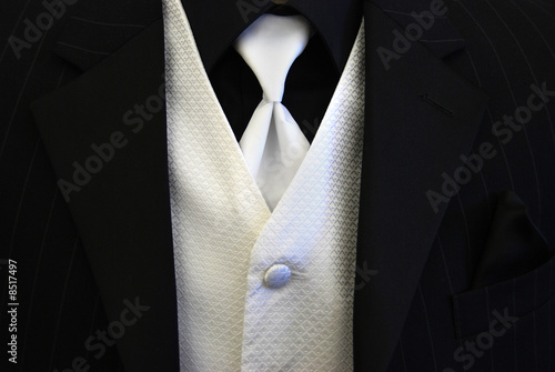 All black suit silver tie