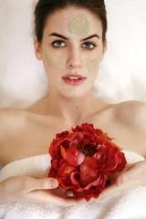Woman having a facial treatment in a spa