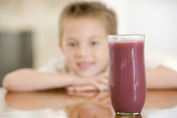 Young boy with focus on juice glass