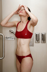 Woman taking a shower at the gym