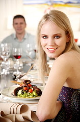 Young woman dining in a restaurant