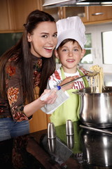 Mother and son cooking spaghetti