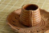 Earthen Pottery Tea Cup and Saucer poster