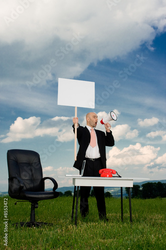 Business man with picket sign