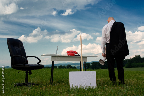 Business man at desk outside