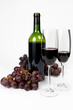 Bottle and two glasses of red wine on white background