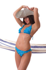 Sexy woman wearing bikini with summer hat
