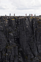 group  of people hiking above abyss
