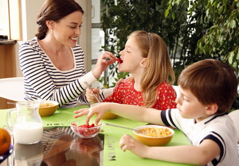 Father and children eating breakfast