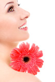 Fototapety Young woman with gerber flower