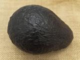 Single avocado at the brown linen poster