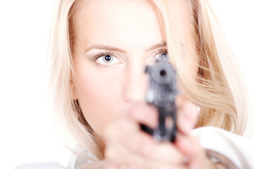 Cute blonde with a gun