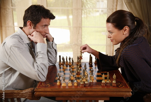 A man and woman playing chess