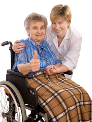 elderly woman in wheelchair giving the thumbs-up sign