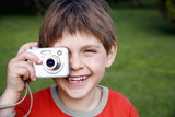 Little boy holding a camera