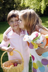 Little boy and girl with Easter egg basket