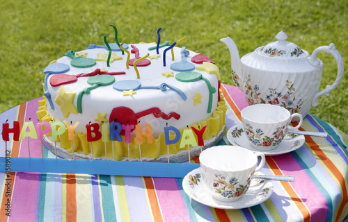 Birthday cake with teapot and cups
