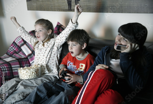 Young people watching television