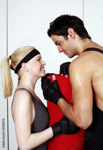 Young man and woman flirting in a fitness class