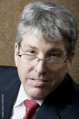 Businessman Lokking Over His Glasses