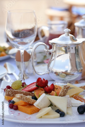 Stylized assortment of fruits and cheeses