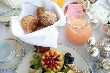 Breakfast table with fruit;breads;juices