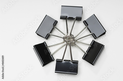 Binder clips on white background