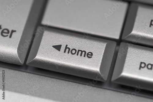 Silver computer keyboard, close-up of Home key