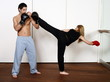 Straight right-hand punch of Active Tae Bo and side kick