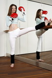 Young woman practicing Capoeira move