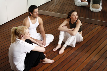 Participants waiting for the fitness class meditating