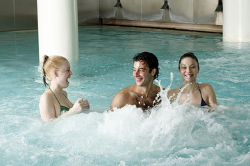 Young people swimming in spa pool