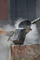 Pouring Steamy Tar