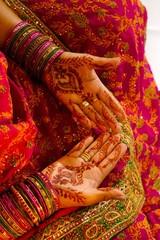 Indian wedding bride getting henna applied